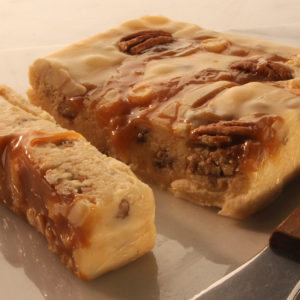 Allen Family Fudge - Vanilla butter pecan fudge with pecans and caramel mixed in a drizzled on top